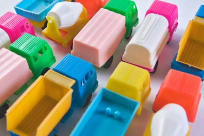 Colorful toy trucks parked together in rows